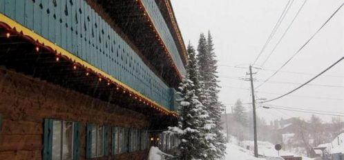 side of lodge in winter