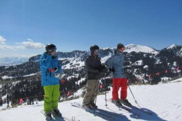 Family on mountain geared up for skiing